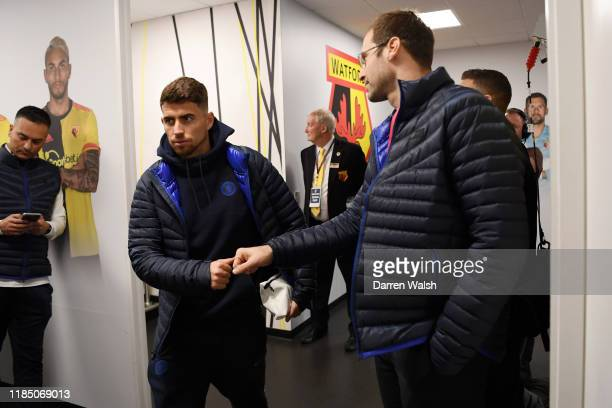 Jorginho of Chelsea high fives Petr Cech as he arrives at the stadium prior to the Premier League match between Watford FC and Chelsea FC at Vicarage...