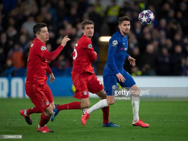 Jorginho of Chelsea in action with Robert Lewandowski and Thomas Muller of FC Bayern Munchen during the UEFA Champions League round of 16 first leg...