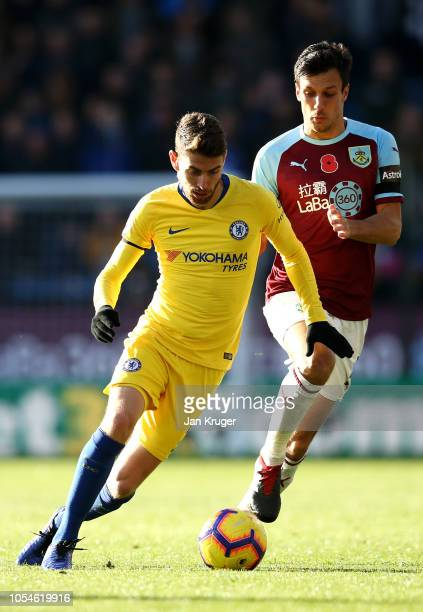 Jorginho of Chelsea is challanged by Jack Cork of Burnley during the Premier League match between Burnley FC and Chelsea FC at Turf Moor on October...