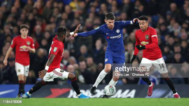 Jorginho of Chelsea is challenged by Fred and Jesse Lingard of Manchester United during the Carabao Cup Round of 16 match between Chelsea and...