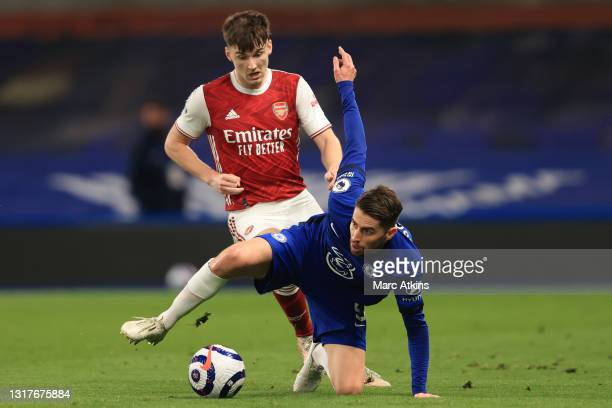 Jorginho of Chelsea is challenged by Kieran Tierney of Arsenal during the Premier League match between Chelsea and Arsenal at Stamford Bridge on May...