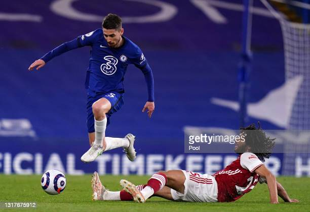 Jorginho of Chelsea is challenged by Mohamed Elneny of Arsenal during the Premier League match between Chelsea and Arsenal at Stamford Bridge on May...