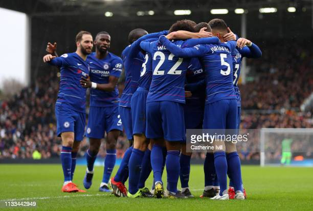 Jorginho of Chelsea is congratulated by his team mates after he scores his teams second goal during the Premier League match between Fulham FC and...