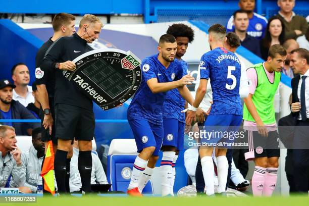 Jorginho of Chelsea is replaced as a substitute by teammate Mateo Kovacic during the Premier League match between Chelsea FC and Leicester City at...