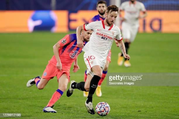 Jorginho of Chelsea, Ivan Rakitic of Sevilla FC during the UEFA Champions League match between Sevilla v Chelsea at the Estadio Ramon Sanchez Pizjuan...