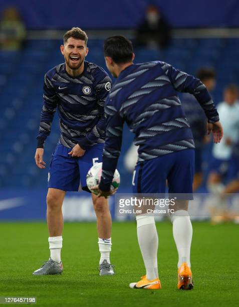 Jorginho of Chelsea jokes with Ben Chilwell in the warm up during the Carabao Cup Third Round match between Chelsea and Barnsley at Stamford Bridge...