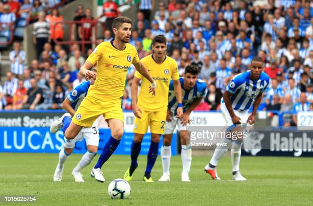 Jorginho of Chelsea scores a penalty for his team's second goal during the Premier League match between Huddersfield Town and Chelsea FC at John...