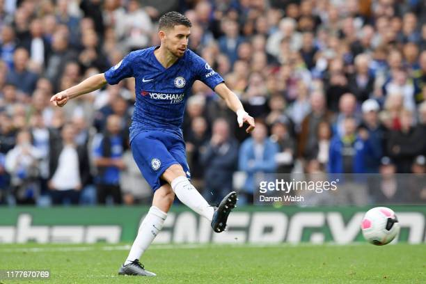 Jorginho of Chelsea scores his team's first goal from the penalty spot during the Premier League match between Chelsea FC and Brighton & Hove Albion...
