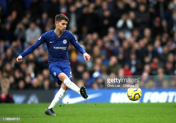 Jorginho of Chelsea scores his team's first goal from the penalty spot during the Premier League match between Chelsea FC and Burnley FC at Stamford...