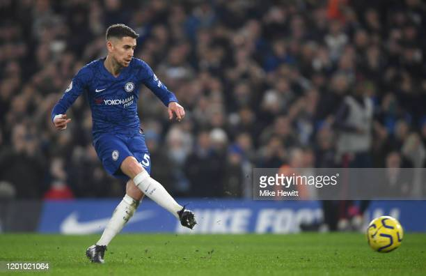 Jorginho of Chelsea scores his team's first goal from the penalty spot during the Premier League match between Chelsea FC and Arsenal FC at Stamford...