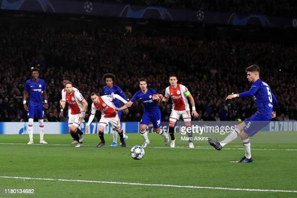Jorginho of Chelsea scores the equaling goal from the penalty spot during the UEFA Champions League group H match between Chelsea FC and AFC Ajax at...