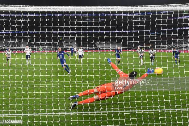 Jorginho of Chelsea scores their team's first goal from the penalty spot past Hugo Lloris of Tottenham Hotspur during the Premier League match...