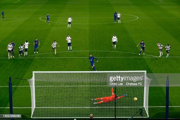 Jorginho of Chelsea scores their team's first goal from the penalty spot past Hugo Lloris of Tottenham Hotspur during the Premier League match...