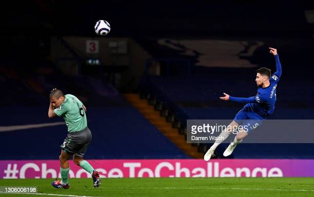 Jorginho of Chelsea shoots over as Allan of Everton turns away during the Premier League match between Chelsea and Everton at Stamford Bridge on...