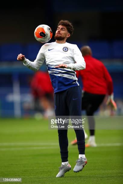 Jorginho of Chelsea shows some skills as he warms up during the Premier League match between Chelsea FC and Watford FC at Stamford Bridge on July 04...