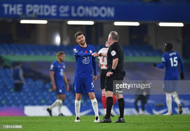 Jorginho of Chelsea speaks with referee Jonathan Moss following following the Premier League match between Chelsea and Sheffield United at Stamford...