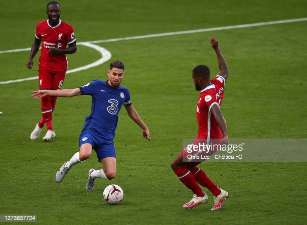 Jorginho of Chelsea tackles Georginio Wijnaldum of Liverpool during the Premier League match between Chelsea and Liverpool at Stamford Bridge on...