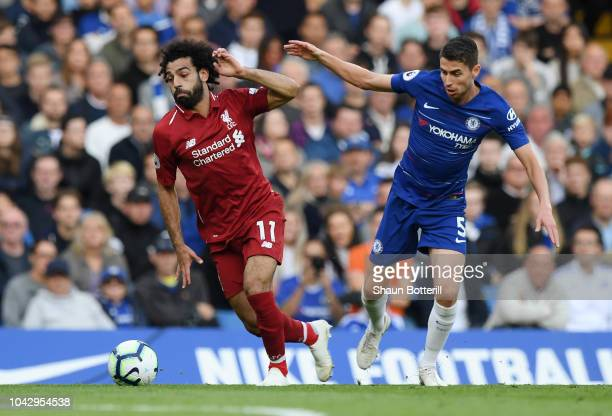 Jorginho of Chelsea tackles Mohamed Salah of Liverpool during the Premier League match between Chelsea FC and Liverpool FC at Stamford Bridge on...