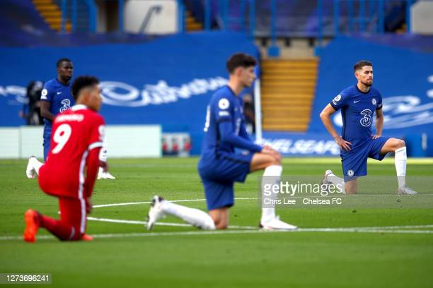 Jorginho of Chelsea takes a knee in support of the Black Lives Matter Movement prior to the Premier League match between Chelsea and Liverpool at...