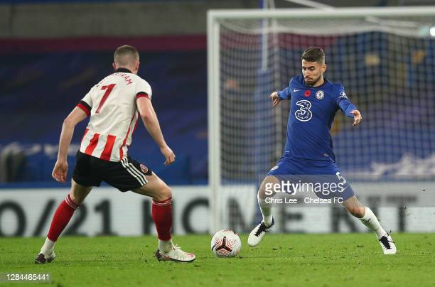 Jorginho of Chelsea takes on John Lundstram of Sheffield during the Premier League match between Chelsea and Sheffield United at Stamford Bridge on...
