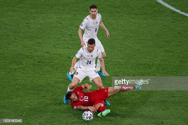 Jorginho of Italy, Alessandro Florenzi of Italy, Hakan Calhanoglu of Turkey during the UEFA Euro 2020 Group A match between Turkey and Italy at...