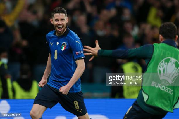 Jorginho of Italy celebrates after scoring the winning penalty in a penalty shoot out during the UEFA Euro 2020 Championship Semi-final match between...