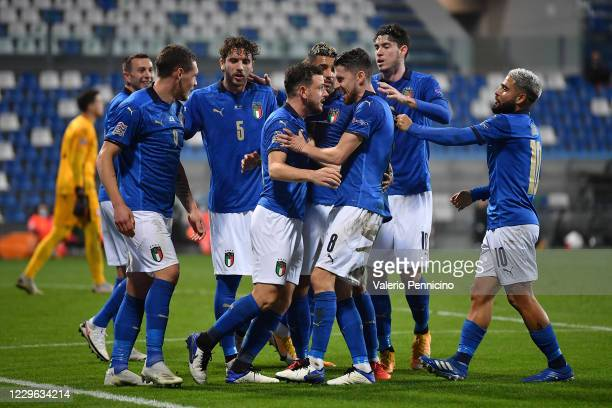 Jorginho of Italy celebrates the opening goal from the penalty spot with team mates during the UEFA Nations League group stage match between Italy...