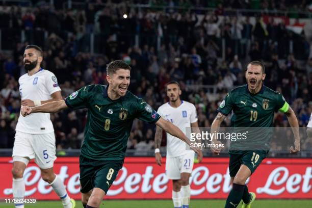 Jorginho of Italy celebrates with his team mates after scoring a goal during the UEFA Euro 2020 qualifying match between Italy and Greece at the...