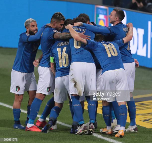 Jorginho of Italy celebrates with his team-mates after scoring the opening goal during the UEFA Nations League group stage match between Italy and...