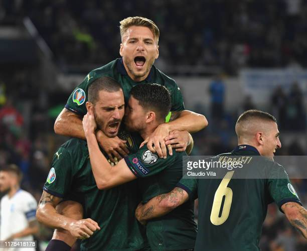 Jorginho of Italy celebrates with teammates after scoring the opening goal during the UEFA Euro 2020 qualifier between Italy and Greece on October 12...
