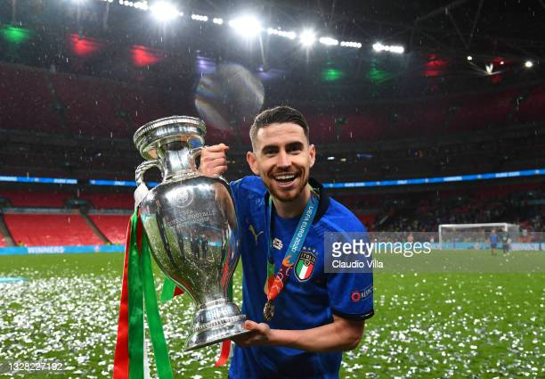 Jorginho of Italy celebrates with The Henri Delaunay Trophy following his team's victory in the UEFA Euro 2020 Championship Final between Italy and...
