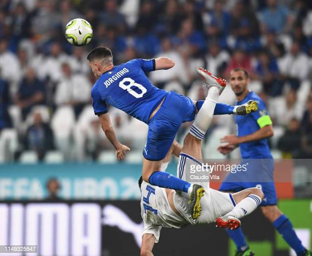 Jorginho of Italy competes for the ball with Amer Gojak of Bosnia during the UEFA Euro 2020 Qualifier between Italy and Bosnia and Herzegovina at...