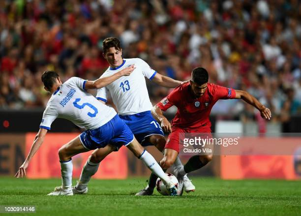 Jorginho of Italy competes for the ball with Andre Silva of Portugal during the UEFA Nations League A group three match between Portugal and Italy at...
