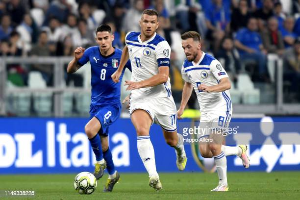 Jorginho of Italy competes for the ball with Edin Dzeko of Bosnia during the UEFA Euro 2020 Qualifier between Italy and Bosnia and Herzegovina at...