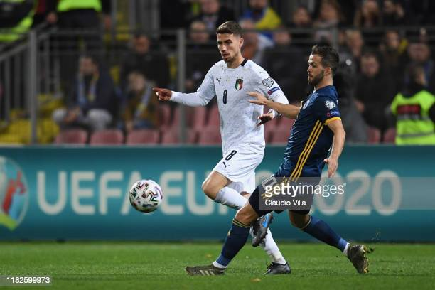 Jorginho of Italy competes for the ball with Miralem Pjanic of Bosnia and Herzegovina during the UEFA Euro 2020 Qualifier between Bosnia and...