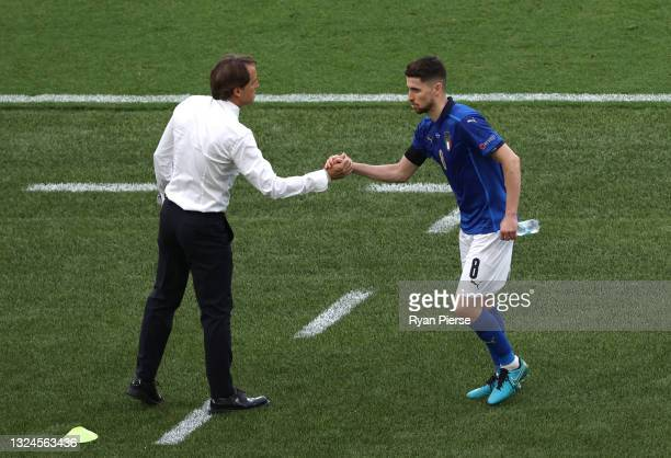 Jorginho of Italy interacts with Roberto Mancini, Head Coach of Italy as he is substituted during the UEFA Euro 2020 Championship Group A match...