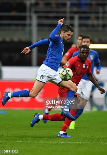 Jorginho of Italy is challenged by William Carvalho of Portugal during the UEFA Nations League A group three match between Italy and Portugal at...