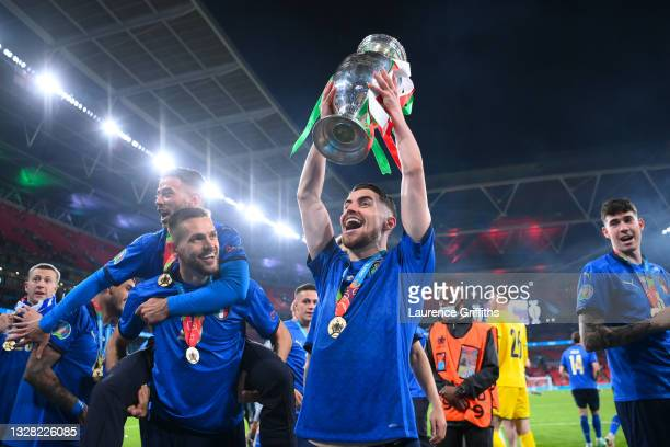 Jorginho of Italy lifts The Henri Delaunay Trophy following his team's victory in the UEFA Euro 2020 Championship Final between Italy and England at...