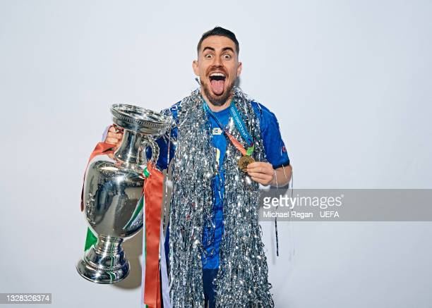 Jorginho of Italy poses with The Henri Delaunay Trophy during an Italy Portrait Session following their side's victory in the UEFA Euro 2020...