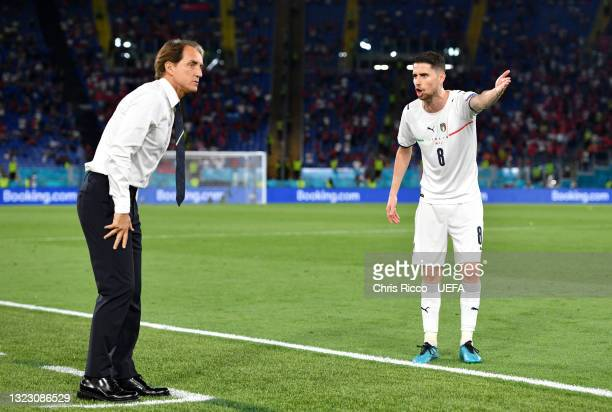 Jorginho of Italy speaks to Roberto Mancini, Head Coach of Italy during the UEFA Euro 2020 Championship Group A match between Turkey and Italy at the...