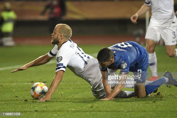 Jorginho of Italy tackles Teemu Pukki of Finland during the UEFA Euro 2020 Group J qualification football match Finland vs Italy in Tampere, Finland...