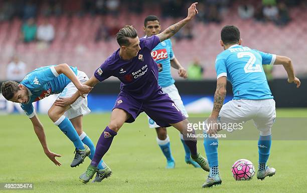 Jorginho of Napoli competes for the ball with Federico Brenardeschi of Fiorentina during the Serie A match between SSC Napoli and ACF Fiorentina at...