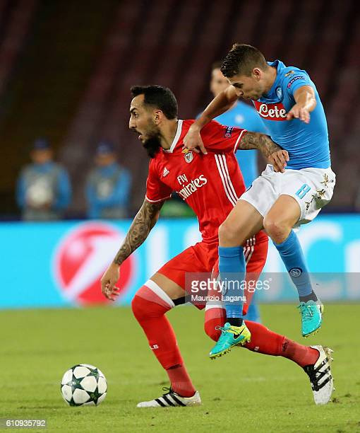 Jorginho of Napoli competes for the ball with Kostas Mitroglou of Benfica during the UEFA Champions League match between SSC Napoli and Benfica at...