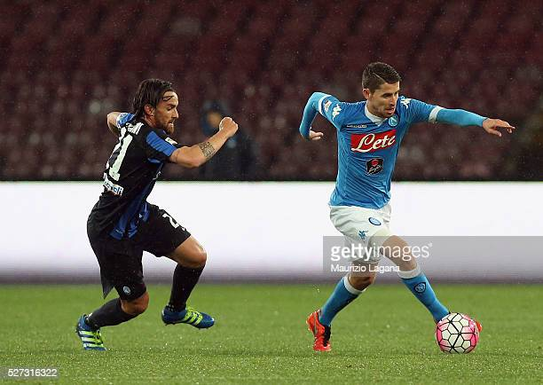 Jorginho of Napoli competes for the ball with Luca Cigarini of Atalanta during the Serie A match between SSC Napoli and Atalanta BC at Stadio San...