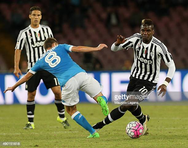 Jorginho of Napoli competes for the ball with Paul Pogba of Juventus during the Serie A match between SSC Napoli and Juventus FC at Stadio San Paolo...