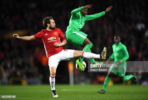 Jorginho of Saint-Etienne and Daley Blind of Manchester United in action during the UEFA Europa League Round of 32 first leg match between Manchester...