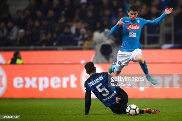 Jorginho of SSC Napoli is tackled by Roberto Gagliardini of FC Internazionale during the Serie A football match between FC Internazionale and SSC...