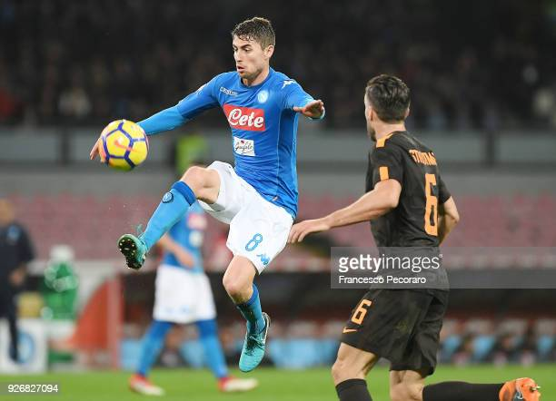 Jorginho of SSC Napoli vies with AS Roma player Kevin Strootman during the serie A match between SSC Napoli and AS Roma Serie A at Stadio San Paolo...