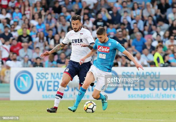 Jorginho of SSC Napoli vies with Federico Ceccherini of FC Crotone during the Serie A match between SSC Napoli and FC Crotone at Stadio San Paolo on...