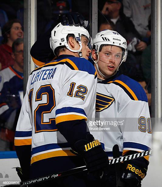 Jori Lehtera and Vladimir Tarasenko of the St. Louis Blues celebrate Tarasenko's insurance goal in the third period against the New York Islanders at...